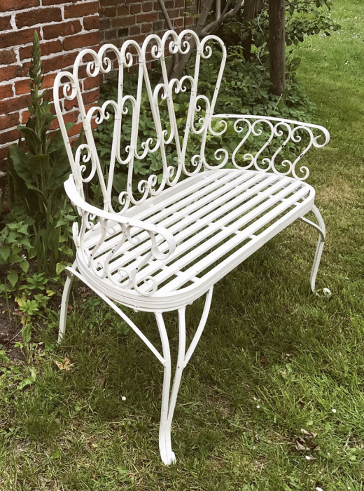 Small white metal garden bench